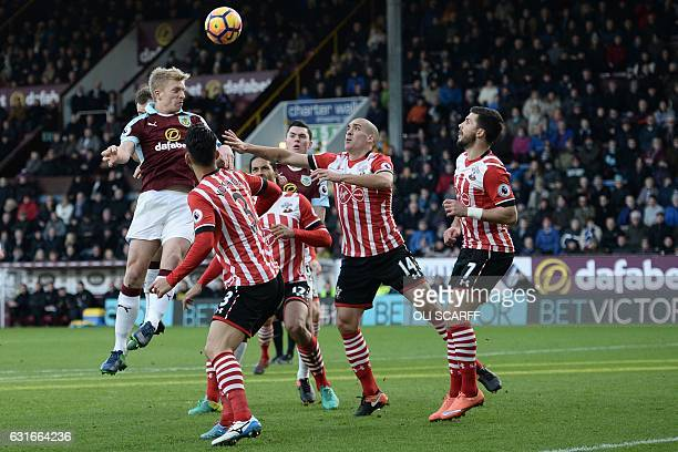 Burnley's English defender Ben Mee misses with this headed attempt during the English Premier League football match between Burnley and Southampton...
