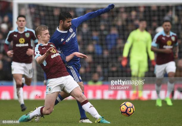 Burnley's English defender Ben Mee vies with Chelsea's Brazilianborn Spanish striker Diego Costa during the English Premier League football match...