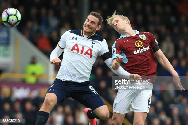 Burnley's English defender Ben Mee vies with Tottenham Hotspur's Dutch striker Vincent Janssen during the English Premier League football match...