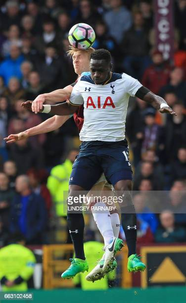Burnley's English defender Ben Mee vies with Tottenham Hotspur's French midfielder Moussa Sissoko during the English Premier League football match...