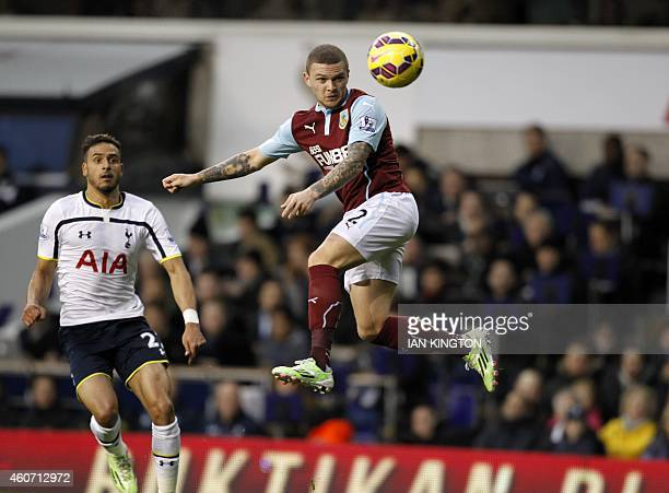 Burnley's English defender Kieran Trippier jumps to win a header during the English Premier League football match between Tottenham Hotspur and...