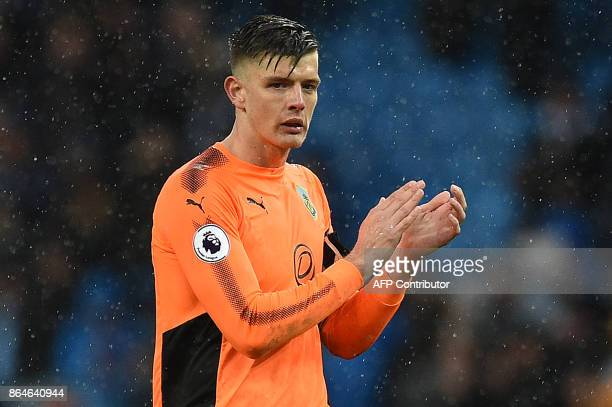 Burnley's English goalkeeper Nick Pope applauds the fans following the English Premier League football match between Manchester City and Burnley at...