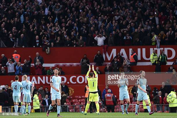 Burnley's English goalkeeper Tom Heaton applauds the fans at the end of the English Premier League football match between Manchester United and...