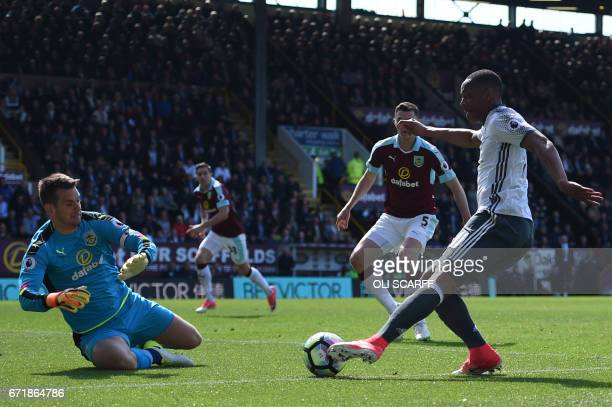 Burnley's English goalkeeper Tom Heaton blocks a shot by Manchester United's French striker Anthony Martial during the English Premier League...