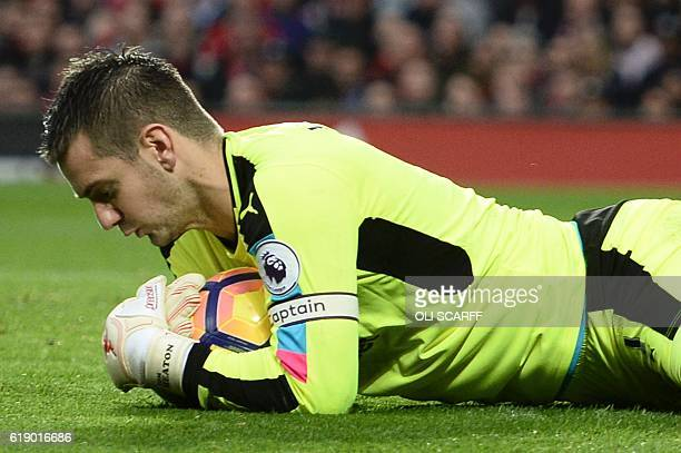 Burnley's English goalkeeper Tom Heaton claims the ball during the English Premier League football match between Manchester United and Burnley at Old...