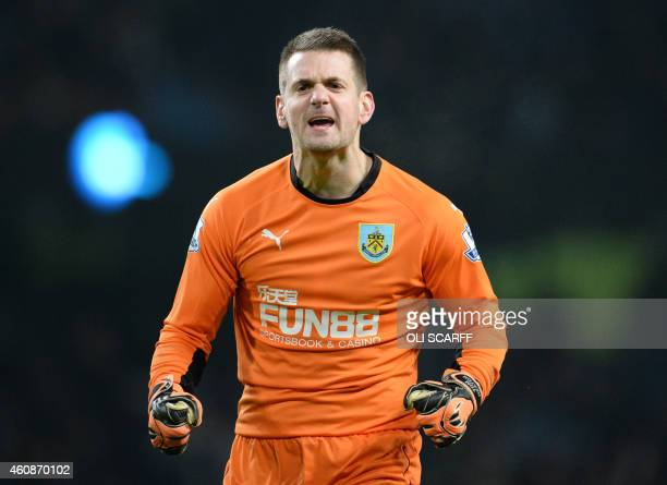 Burnley's English goalkeeper Tom Heaton reacts at the final whistle in the English Premier League football match between Manchester City and Burnley...