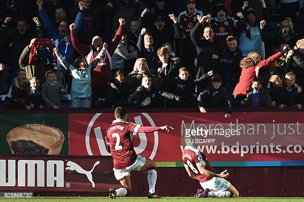 Burnley's English midfielder Dean Marney celebrates after scoring the opening goal of the English Premier League football match between Burnley and...