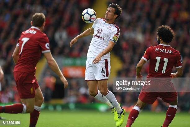 Burnley's English midfielder Jack Cork controls the ball during the English Premier League football match between Liverpool and Burnley at Anfield in...