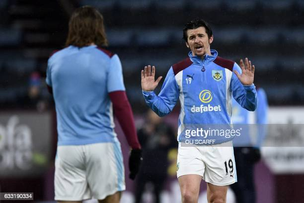 Burnley's English midfielder Joey Barton warms up ahead of the English Premier League football match between Burnley and Leicester City at Turf Moor...