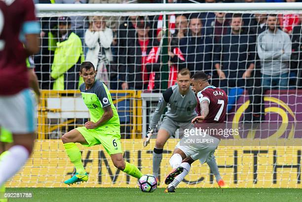 Burnley's English striker Andre Gray prepares to shoot past Liverpool's Belgian goalkeeper Simon Mignolet for Burnley's second goal during the...