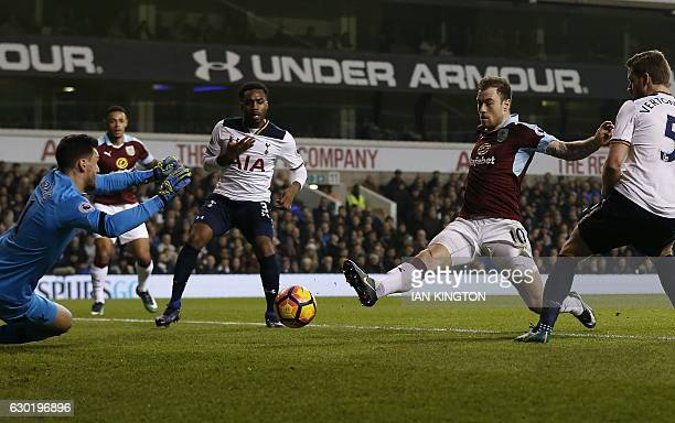 Burnley's English striker Ashley Barnes scores his team's first goal past Tottenham Hotspur's French goalkeeper Hugo Lloris during the English...
