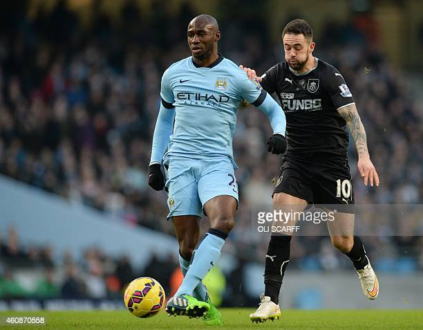 Burnley's English striker Danny Ings vies with Manchester City's French defender Eliaquim Mangala during the English Premier League football match...
