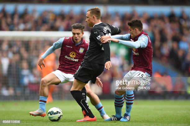 Burnley's Fredrik Ulvestad is challenged by Aston Villa's Jack Grealish and Ashley Westwood