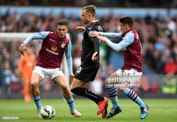 Burnley's Fredrik Ulvestad is marked by Aston Villa's Jack Grealish and Ashley Westwood