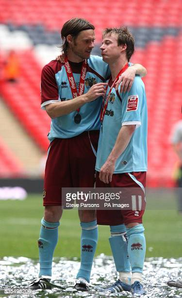 Burnley's Graham Alexander and Wade Elliott after the match during the Championship PlayOff Final at Wembley London
