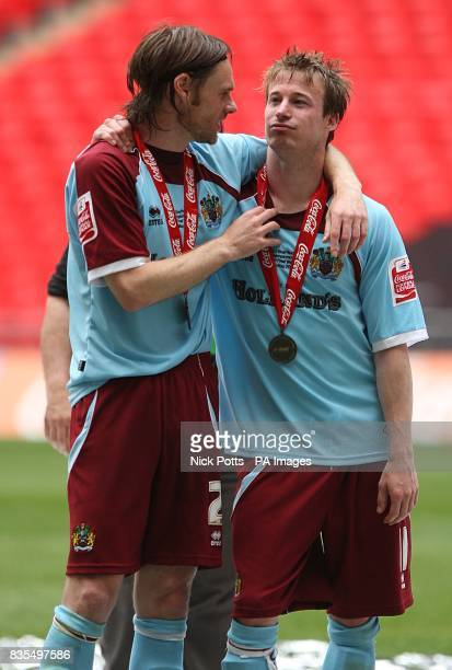Burnley's Graham Alexander and Wade Elliott celerbate after gaining promotion into the Premier League