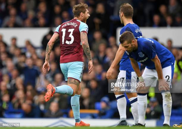 Burnley's Irish midfielder Jeff Hendrick celebrates after scoring the opening goal of the English Premier League football match between Everton and...