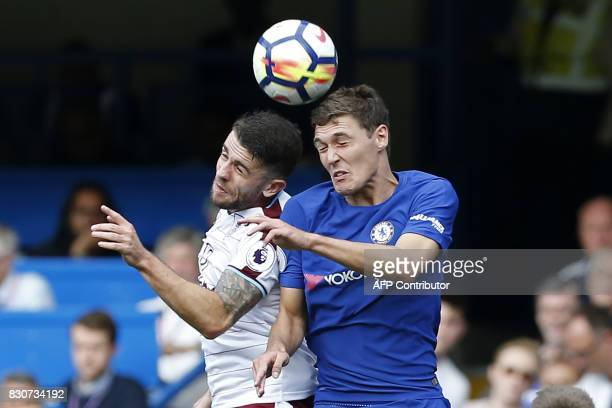 Burnley's Irish midfielder Robbie Brady vies with Chelsea's Danish defender Andreas Christensen during the English Premier League football match...