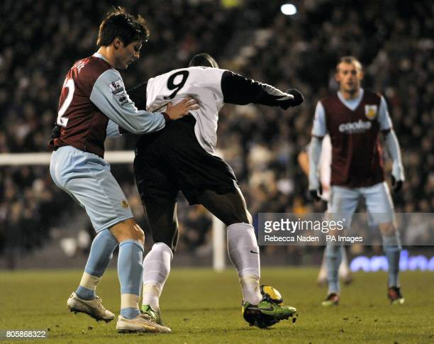 Burnley's Jack Cork in action against Fulham's Stefano Okaka Chuka