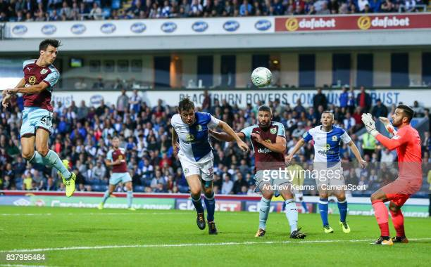 Burnley's Jack Cork scores their first goal with a header during the Carabao Cup Second Round match between Blackburn Rovers and Burnley at Ewood...