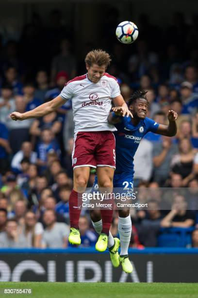 Burnley's James Tarkowski battles for possession with Chelsea's Michy Batshuayi during the Premier League match between Chelsea and Burnley at...