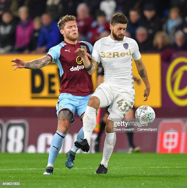 Burnley's Jeff Hendrick battles with Leeds United's Mateusz Klich during the Carabao Cup Third Round match between Burnley and Leeds United at Turf...