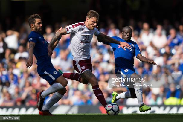 Burnley's Jeff Hendrick under pressure from Chelsea's Ngolo Kante and Chelsea's Cesc Fabregas during the Premier League match between Chelsea and...
