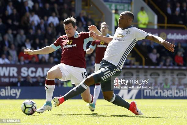Burnley's Joey Barton and Manchester United's Anthony Martial battle for the ball during the Premier League match at Turf Moor Burnley