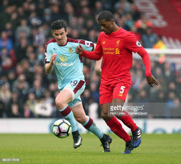 Burnley's Joey Barton vies for possession with Liverpool's Georginio Wijnaldum during the Premier League match between Liverpool and Burnley at...