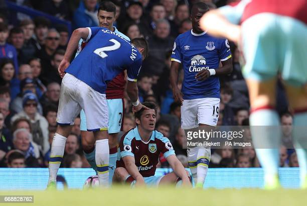 Burnley's Joey Bartons sits on the floor after being fouled by Everton's Morgan Schneiderlin during the Premier League match at Goodison Park...
