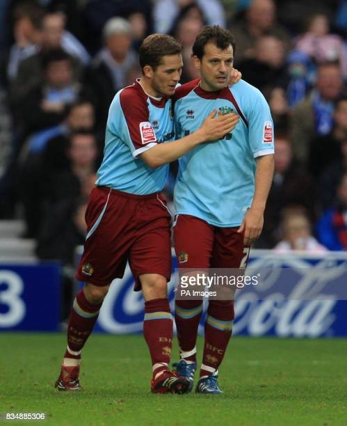 Burnley's Joey Gudjonsson congratulates Robbie Blake on scoring the equalizer during the CocaCola Football Championship match at Loftus Road London