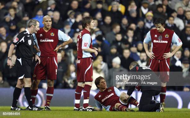 Burnley's Joey Gudjonsson picks up an injury early in the first half