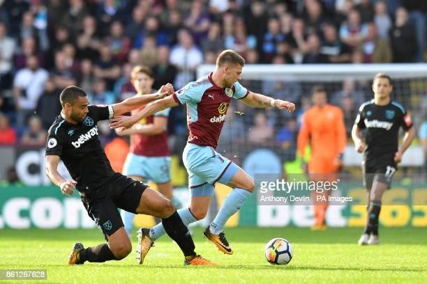 Burnley's Johann Berg Gudmundsson amd West Ham United's Winston Reid battle for the ball during the Premier League match at Turf Moor Burnley