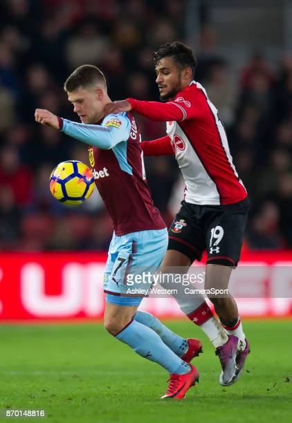 Burnley's Johann Gudmundsson holds off the challenge from Southampton's Sofiane Boufal during the Premier League match between Southampton and...
