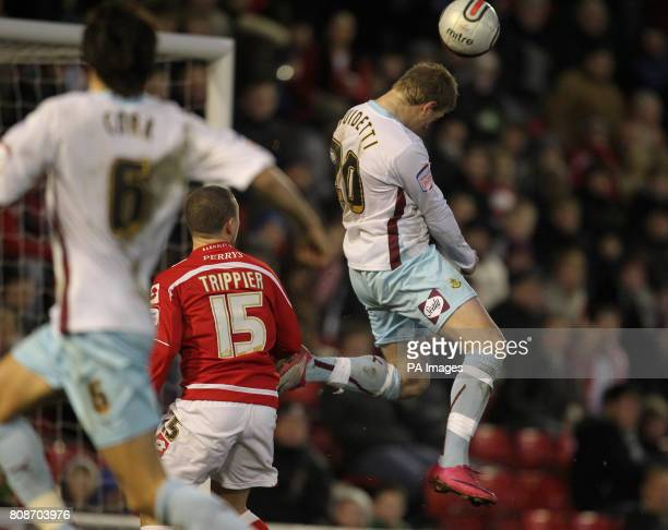Burnley's John Guidetti scores his sides first goal during the npower Championship match at Oakwell Barnsley