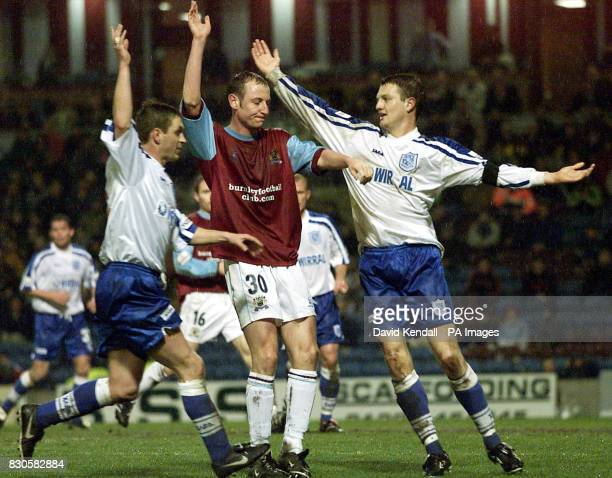 Burnley's John Mullin and Tranmere Rovers' Clint Hill both appeal to claim the ball during the Nationwide Division One game at Turf Moor Burnley