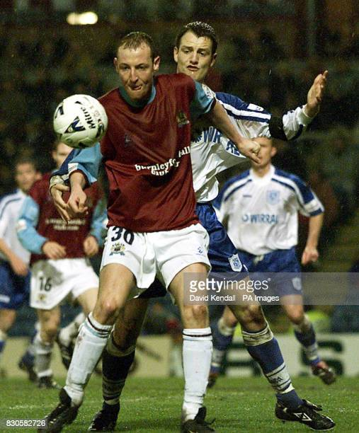Burnley's John Mullin comes under pressure from Tranmere Rovers' Captain Clint Hill during their Nationwide Division One match at Turf Moor Burnley