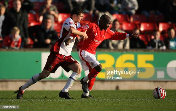Burnley's John Spicer and Barnsley`s Jamal CampbellRyce during the CocaCola Football League Championship match at the Oakwell Ground Barnsley PRESS...