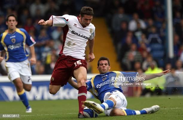 Burnley's John Spicer and Cardiff City's Joe Ledley battle for the ball