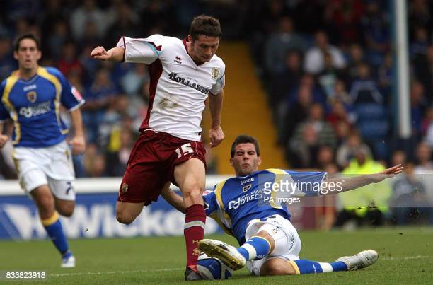 Burnley's John Spicer and Cardiff City's Joe Ledley battle for the ball during the CocaCola Championship match at Ninian Park Cardiff