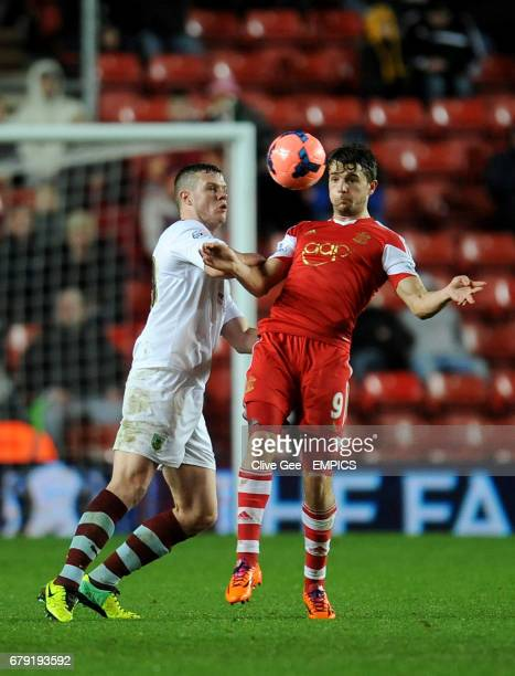Burnley's Kevin Long and Southampton's Jay Rodriguez battle for the ball during the FA Cup Third Round match at St Mary's Southampton