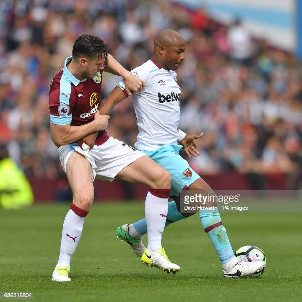 Burnley's Kevin Long battles with West Ham United's Andre Ayew during the Premier League match at Turf Moor Burnley