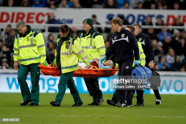 Burnley's Kevin Long is carried off on a stretcher due to injury