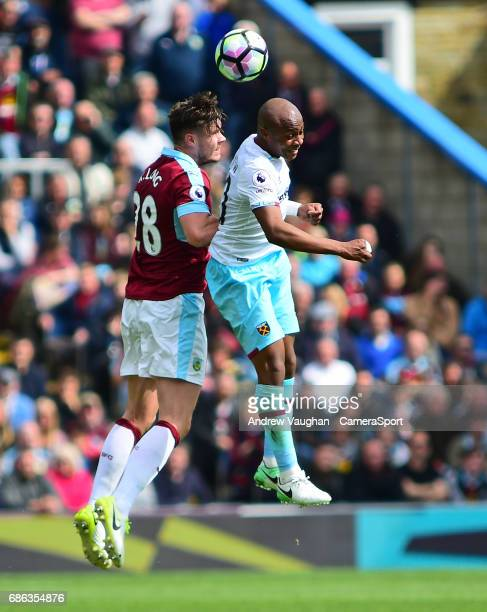 Burnley's Kevin Long vies for possession with West Ham United's Andre Ayew during the Premier League match between Burnley and West Ham United at...