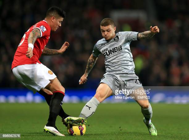 Burnley's Kieran Trippier and Manchester United's Marcos Rojo battle for the ball