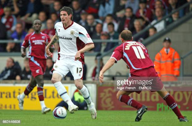 Burnley's Kyle Lafferty takes the ball away from Scunthorpe United's Ian Baraclough