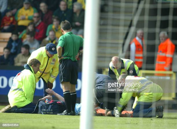 Burnley's Lee Briscoe is put on to a stretcher after hurting his leg during the game against Norwich City