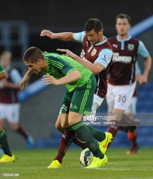 Burnley's Lukas Jutkiewicz and Celta Vigo's Santi Mina battle for the ball