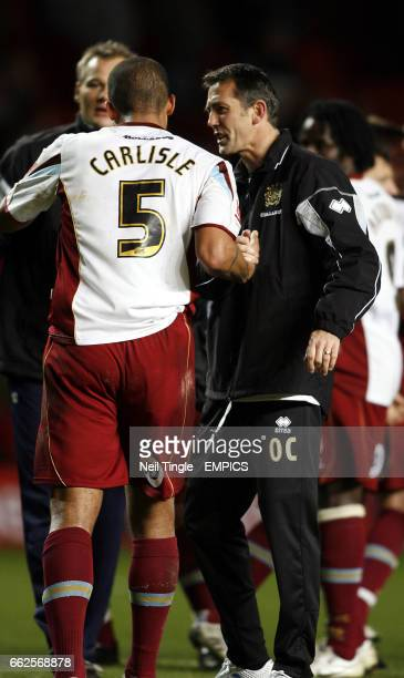 Burnley's manager Owen Coyle celebrates with Clarke Carlisle at full time