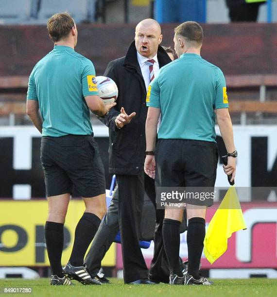 Burnley's Manager Sean Dyche has words with referee Robert Madley during the npower Football League Championship match at Turf Moor Burnley